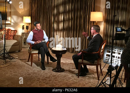 Secretary of Defense Ash Carter is interviewed by Vishnu Som of NDTV in New Dehli, India, April 12, 2016. Carter is visiting India to solidify the rebalance to the Asia-Pacific region.(Photo by Senior Master Sgt. Adrian Cadiz)(Released) - Stock Photo