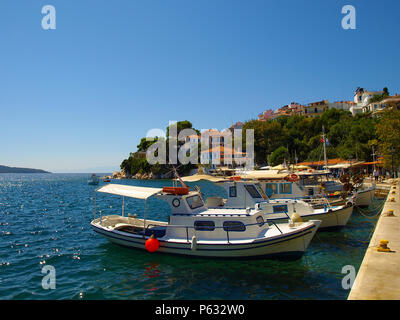 Small fishing boats anchored in the harbour of Skiathos town, Greece - Stock Photo