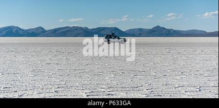 Off-road car in the Salar de Uyuni is largest salt flat in the World UNESCO World Heritage Site - Altiplano, Bolivia - Stock Photo