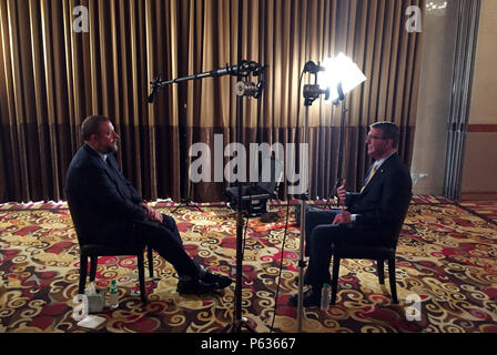 Secretary of Defense Ash Carter is interviewed by Shane Smith of Vice in Manila, Philippines April 16, 2016. Carter is visiting the Philippines to solidify the rebalance to the Asia-Pacific region.(Photo by Senior Master Sgt. Adrian Cadiz)(Released) - Stock Photo