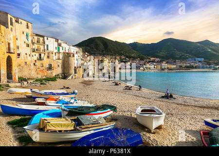 Traditional colorful houses In Cefalu' village over sunset,Sicily,Italy. - Stock Photo