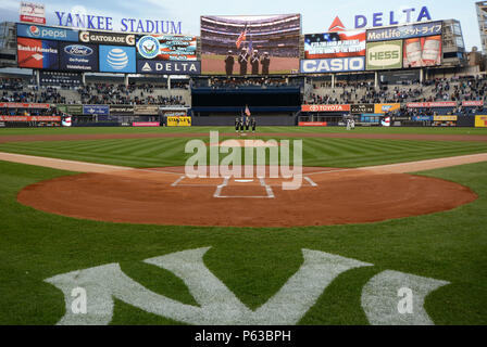 160406-N-UN744-015 NEW YORK (April 6, 2016) The U.S. Navy Recruiting District New York color guard presents colors during the national anthem at Yankee Stadium just prior to the New York Yankees' second game of the season against the Houston Astros. The New York district's Navy recruiters, many from New York themselves, recruit the best men and women for America's all-volunteer Navy. (U.S. Navy photo by Chief Mass Communication Specialist Travis Simmons/Released) - Stock Photo