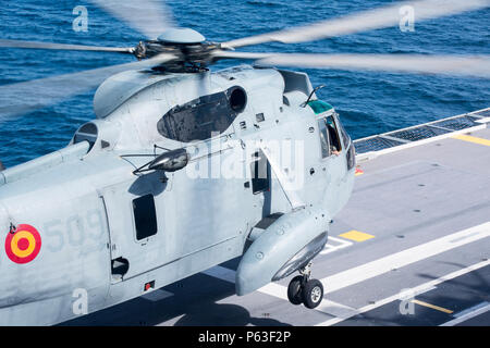 A Spanish SH-3D Sea King helicopter lands aboard the ESPS Juan Carlos I during Amphibious Exercise 16.1, Apr. 18, 2016. SPMAGTF-CR-AF conducted AMPHIBEX in order to sustain and improve core and assigned mission essential tasks and to build amphibious interoperability with Spanish Combat Group 2 and Spanish Marine Brigade. (U.S. Marine Corps photo by Sgt. Kassie L. McDole/Released) - Stock Photo