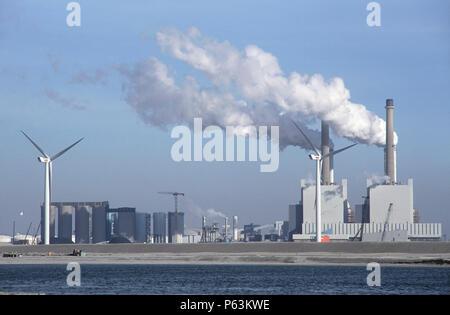 Windmill alongside coal fired power station in the Maasvlakte outer Rotterdam docks, Netherlands - Stock Photo