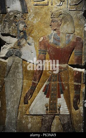 King Seti I in front of the God Osiris. Fragment of a pillar. Limestone. New Kingdom. 19th Dynasty. 1290 BC. Grave of Seti I. West Thebes. Valley of the Kings. Neues Museum. Berlin. Germany. - Stock Photo