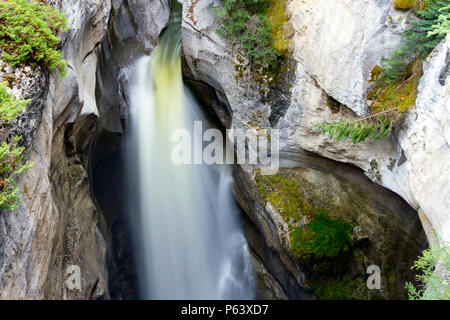 Maligne Canyon is a natural feature located in the Jasper National Park near Jasper, Alberta, Canada. Eroded out of the Palliser Formation. - Stock Photo