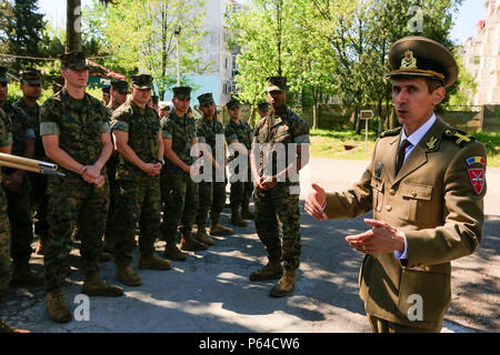 Romanian Lt. Col. Catalin Cracea, public affairs officer of the 9th Mechanized Brigade 'Marasesti', welcomes U.S. Service members to military national museum 'Ferdinand I,' the Constanta branch, to celebrate Land Forces Day in Constanta, Romania, April 22, 2016. Romanian soldiers celebrate this holiday throughout the country to honor the sacrifice of their forefathers and to evoke spirit de corps. (U.S. Marine Corps photo by Cpl. Kelly L. Street, 2D MARDIV COMCAM/Released) - Stock Photo