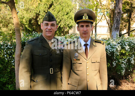 U.S. Marine Corps Maj. Christopher M. Reynolds, the executive officer of Black Sea Rotational Force, and Romanian Land Force Lt. Col. Catalin Cracea, public affairs officer of the 9th Mechanized Brigade 'Marasesti', pose for a photograph as they celebrate Land Forces Day in Constanta, Romania, April 22, 2016. Romanian soldiers shared the celebration of this holiday with U.S. Service members. Land Forces Day honors the sacrifice of the Romanians' forefathers and evokes the combat traditions of military units. (U.S. Marine Corps photo by Cpl. Kelly L. Street, 2D MARDIV COMCAM/Released) - Stock Photo