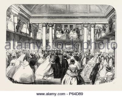 LITERARY REUNION IN MR. MUDIE'S NEW HALL, 1860 engraving. - Stock Photo