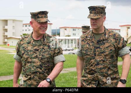 U.S. Marine Corps Lt. Gen. Lawrence D. Nicholson, commanding general of the III Marine Expeditionary Force, walks with U.S. Marine Corps Col. Romin Dasmalchi, commanding officer of the 31st Marine Expeditionary Unit, on Camp Hansen, Okinawa, Japan, April 26, 2016. Nicholson commended Marines of the 31st MEU for their participation in the Japan earthquake relief efforts from April 18-23, 2016. (U.S. Marine Corps Photo by Cpl. Darien J. Bjonrdal, 31st Marine Expeditionary Unit/ Released) - Stock Photo