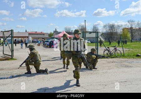 Estonian Soldiers of 2nd Infantry Brigade, Kuperjanov Battalion, move through an open market in the center of town during an urban operations exercise, Voru, Estonia, April 30,2016. (Photo by U.S. Army Staff Sgt. Steven M. Colvin/Released) - Stock Photo