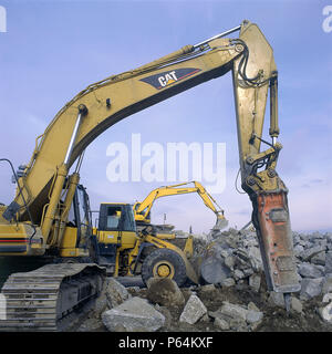 Hydraulic breaker attachment on Caterpillar excavator with