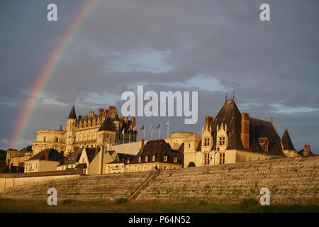 A colorful rainbow shining above the old medieval stone castle of Amboise, France on the river Loire - Stock Photo