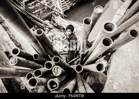 Worker Removing Pipes in River on a Construction Site - Stock Photo