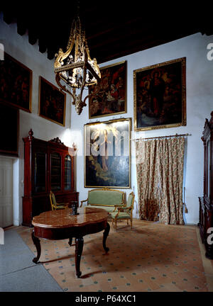 Framed picture in living room with furniture and chandelier,Casa Pilatos,Sevilla,Spain - Stock Photo
