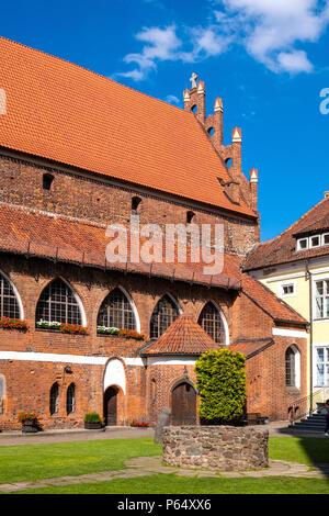 Olsztyn, Warmian-Masurian / Poland - 2018/06/16: Main wing and inner courtyard of the Warmian Bishops Castle in historical quarter of Olsztyn old town - Stock Photo