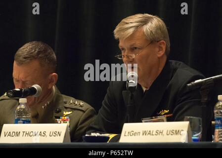 160516-N-XO220-014  NATIONAL HARBOR, Md. (May 16, 2016) Vice Adm. Robert Thomas, director, Navy Staff, speaks during a naval integration roundtable during the 2016 Sea-Air-Space Exposition. The Sea-Air-Space Exposition is an annual event that brings together key military decision makers, the U.S. defense industrial base and private-sector U.S. companies for an innovative and educational maritime based event. (Mass Communication Specialist 3rd Eric S. Brann/Released) - Stock Photo