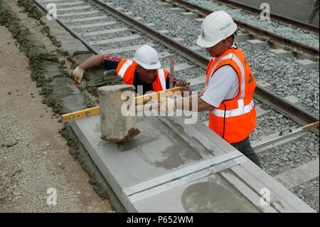 New platform coping stones being placed into position during the modernisation of Tring station as part of the West Coast Main Line upgrade. June 2004 - Stock Photo