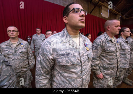 Senior Airman Willie Cruz-Moya, 108th Wing, New Jersey Air National Guard along with Airmen from the 108th and the 177th Fighter Wing stand at attention after receiving the Humanitarian Service Medal at an award ceremony at the National Guard Armory in Lawrenceville, N.J., May 3, 2016. More than 80 New Jersey Army and Air Guard members received the Humanitarian Service Medal for their assistance in the Superstorm Sandy rescue, recovery, and rebuilding efforts. More than 2,200 Soldiers and Airmen who took part in the largest domestic mobilization in the New Jersey National Guard's history will  - Stock Photo