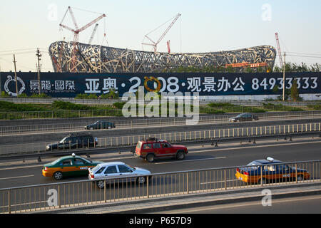 The Beijing National Stadium under construction. The Beijing National Stadium, also known as the bird's nest will be the main track and field stadium  - Stock Photo