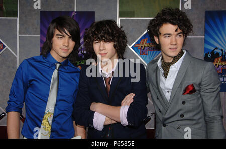 Jonas  Brothers  arriving at the HANNAH MONTANA Miley Cyrus Premiere at El Capitan Theatre In Los Angeles.  horizontale eye contact            -            JonasBrothers_28.jpgJonasBrothers_28  Event in Hollywood Life - California, Red Carpet Event, USA, Film Industry, Celebrities, Photography, Bestof, Arts Culture and Entertainment, Topix Celebrities fashion, Best of, Hollywood Life, Event in Hollywood Life - California, Red Carpet and backstage, ,Arts Culture and Entertainment, Photography,    inquiry tsuni@Gamma-USA.com ,  Music celebrities, Musician, Music Group, 2000 to 2009 - Stock Photo