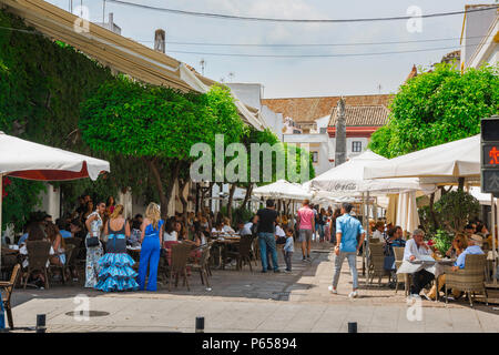 Cordoba cafe bar, view of people sitting outside cafes and bars in the popular Calle Enrique Romero Torres in the city of Cordoba, Andalucia, Spain. - Stock Photo
