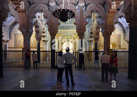 Cordoba Spain mosque, rear view of tourists looking at the Mihrab inside the grand Cathedral / Mosque (La Mezquita) in Cordoba (Cordova), Spain. - Stock Photo