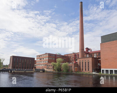 The old power station and industrial architecture along the Tammeroski river in Tampere Finland - Stock Photo