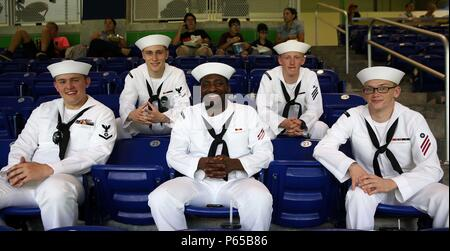 Sailors from the USS Bataan pose for a picture during a Miami Marlins game as part of Fleet Week Port Everglades, Fort Lauderdale, Fla., May 5, 2016. Fleet Week, which takes place in Fort Lauderdale, Fla., from May 2-8, will give the community of South Florida the opportunity to interact with the Marines and Sailors of the ship as well as see up-close and personal some of the capabilities and equipment the Marine Corps employs. (U.S. Marine Corps photo by Lance Cpl. Brianna Gaudi/Released.) - Stock Photo