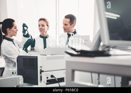 Professional doctors teaching their assistant - Stock Photo