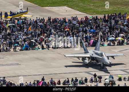 Japanese locals view static displays of F/A-18C/D, AV-8, MV