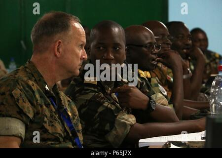 Col. Michael Murphy (left) of the U.S. Marine Corps Reserves, and Lt. Col. Yakouba Toure (right) with the Guinea military, both Western Accord 16 Chiefs of Staff, attend a United Nations based academics class 4, 2016 at Camp Zagre, Ouagadougou, Burkina Faso. Exercise participants from 25 different nations, 15 African regional countries and eight western partners, participated in United Nations based academic classes in preparation for a joint/combined command post exercise. (U.S. Army photo by Staff Sgt. Candace Mundt/Released) - Stock Photo
