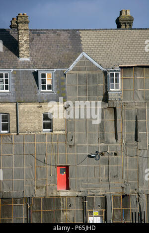 Sidewall of houses protected with plastic sheets during the construction of a new housing development - Stock Photo