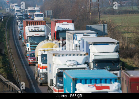 Lorries in traffic jam on dual carriageway, England, UK - Stock Photo