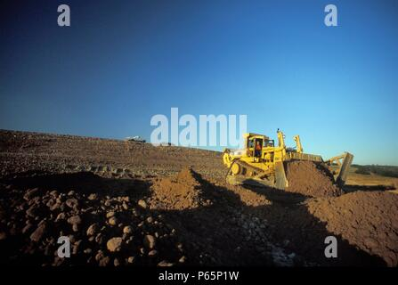 Bulldozer moving dirt for large California housing development, USA - Stock Photo