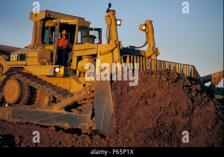 Bulldozer pushing dirt for large housing development in California< USA - Stock Photo