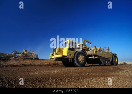 Scrapers and bulldozer working on road building for large California housing project, USA - Stock Photo