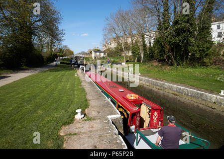narrowboat in number 12 lock as it floods with boat rising Kennet and Avon Canal Bath England UK - Stock Photo
