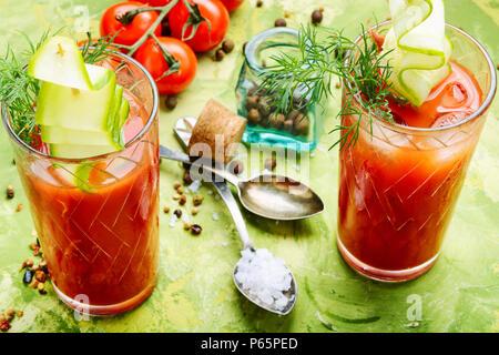 Glass of fresh tomato juice and fresh tomatoes - Stock Photo