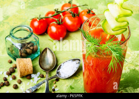Glass of fresh tomato juice and fresh tomatoes - Stock Photo