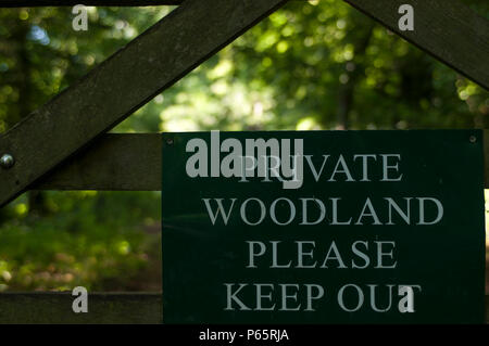 Private woodland keep out, no public access sign in the Dorset countryside, UK - Stock Photo