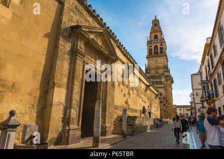 Cordoba Old City, view at sunset of the outer wall and belfry tower of the Mezquita cathedral mosque in the old city quarter of Cordoba, Spain. - Stock Photo