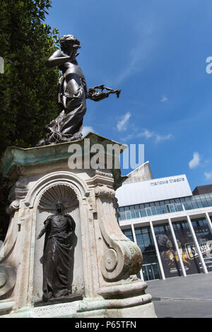 City of Canterbury, England. The Edward Onslow Ford sculpted Marlowe memorial named 'The Muse of Poetry', with the Marlowe Theatre in the background. - Stock Photo