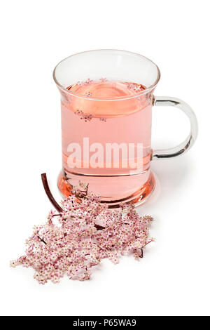 Glass with pink elderberry blossom tea isolated on white background - Stock Photo