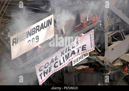 Brown coal open cast mining, North Westphalia. Greenpeace activists occupying the coal digger in Dueren / Luftaufnahme. - Stock Photo