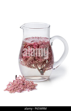 Glass can with cold pink elderberry blossom drink isolated on white background - Stock Photo
