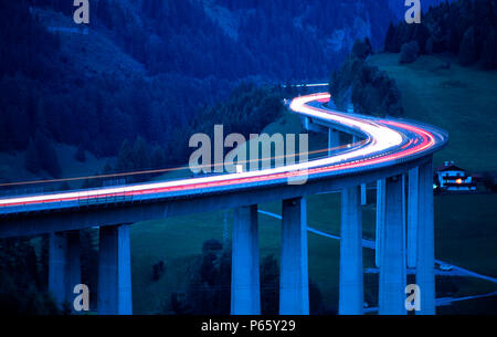 The Brenner Highway at dawn. This is the most important road over the Central Alps. It connects Austria's Tyrol region with Southern Tyrol region in I - Stock Photo