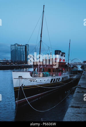 The old steamer on the Clyde River dock in the evening, WAVERLEY is the last sea-going paddle steamer in the world, Glasgow, United Kingdom - Stock Photo
