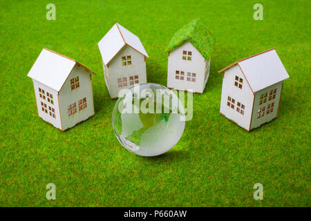 White Houses Arranged In Row On Grassy Field - Stock Photo