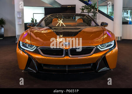 BERLIN - JUNE 09, 2018: Showroom. A plug-in hybrid sports car BMW i8 Roadster. - Stock Photo
